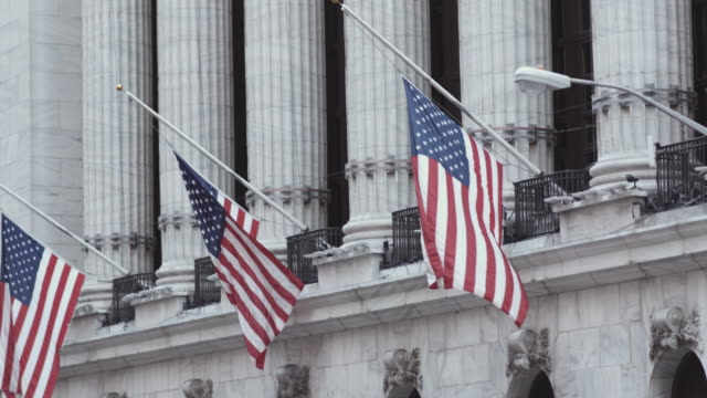 flags above the new york stock exchange. - federal building stock videos & royalty-free footage