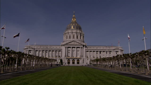 Flags adorn the grass courtyard in front of San Francisco's City Hall. Available in HD.