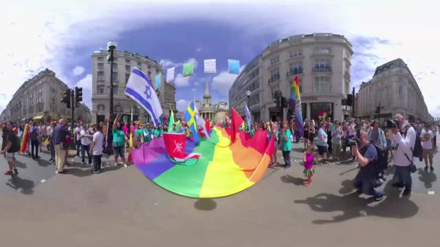 Flags and banners showing unity on pride are waved in support of the movement during London pride