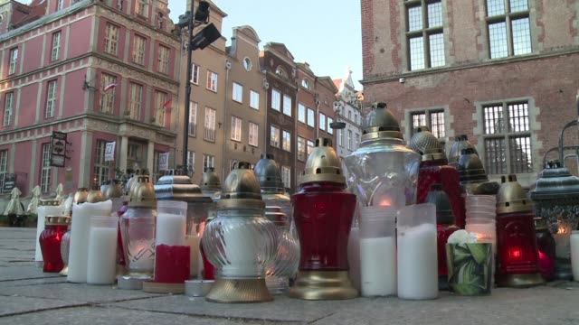 flags are at half mast on the buildings of gdansk and candles burn on the ground to pay tribute to pawel adamowicz the mayor of the city for more... - mayor stock videos & royalty-free footage