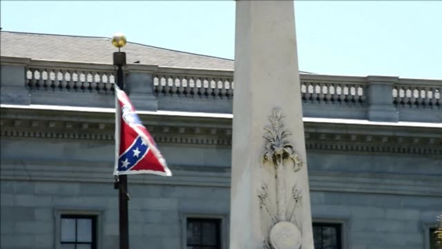 flags are flying at half staff in south carolina since thursday after the cold blooded killing of nine black people in an historic african american... - confederate flag stock videos & royalty-free footage