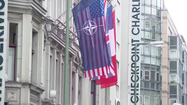 flags at checkpoint charlie in berlin - french flag stock videos & royalty-free footage