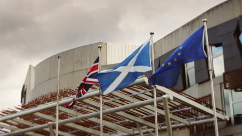 flags at scottish parliament building - parliament building stock videos & royalty-free footage