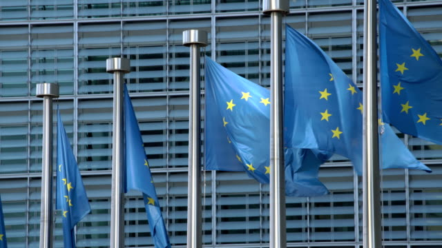eu flags at the european commission headquarters - politik und regierung stock-videos und b-roll-filmmaterial