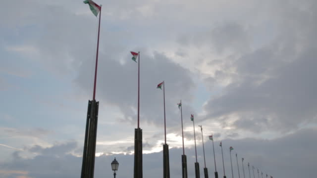 flags behind buda castle - royal palace of buda stock videos & royalty-free footage