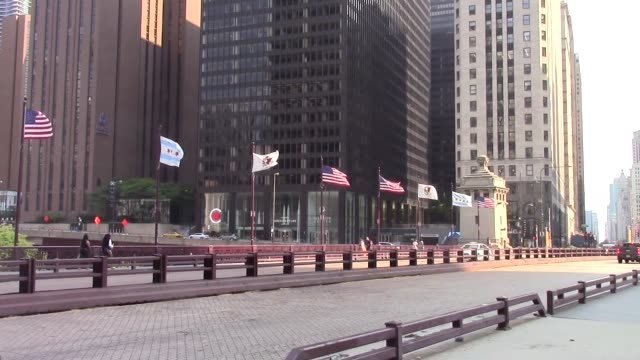 flags blowing along the dusable bridge among general views of chicago, illinois on july 06 as major cities in the u.s. continue to adjust to measures... - dusable bridge stock videos & royalty-free footage