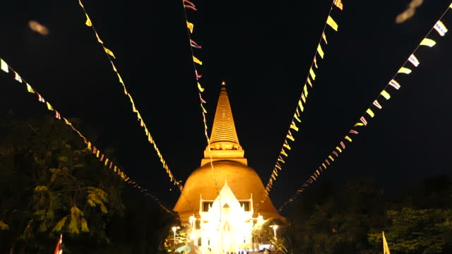 Flags blowing in front of the Golden Stupa