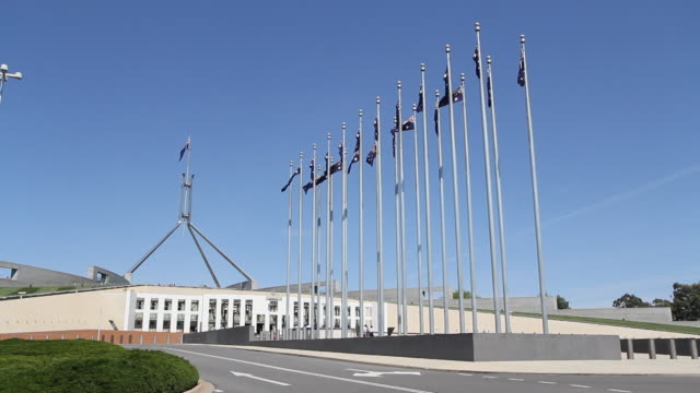 m/s flags by parliament house exterior - canberra stock videos & royalty-free footage