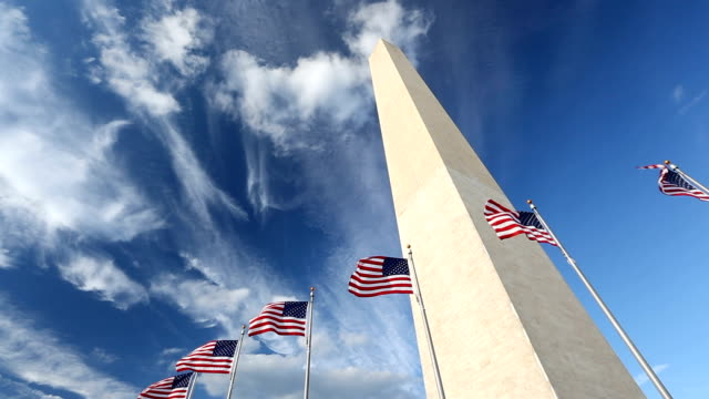 flags by the washington monument - monument stock videos & royalty-free footage