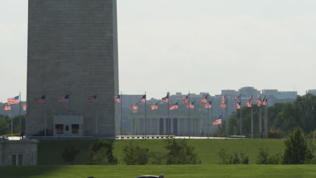 Flags encircling the base of the Washington Monument on a windy day. Shot in 2012.