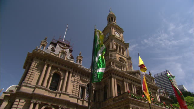 flags flutter outside sydney town hall. - australian politics stock videos & royalty-free footage
