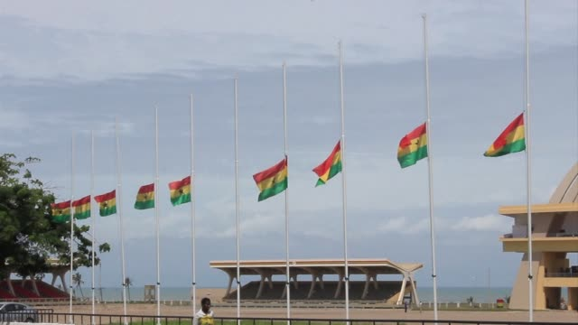 flags fly at half mast in ghana as three days of mourning began to honour more than 150 killed in a petrol station fire during heavy flooding in the... - petrol stock videos & royalty-free footage