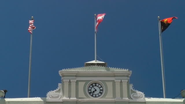 flags fly atop government building - puerto rico stock videos & royalty-free footage