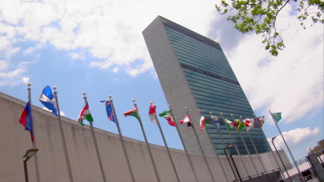 Flags fly in front of the United Nations headquarters in New York City.
