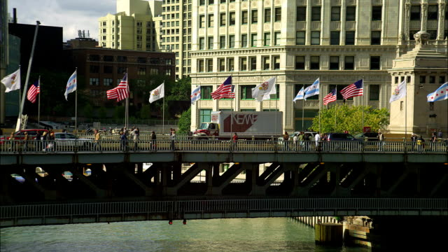 Flags fly in the wind on Chicago's Michigan Avenue Bridge.
