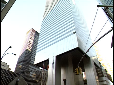 flags fly outside the citicorp center in manhattan. - citigroup center manhattan stock videos & royalty-free footage