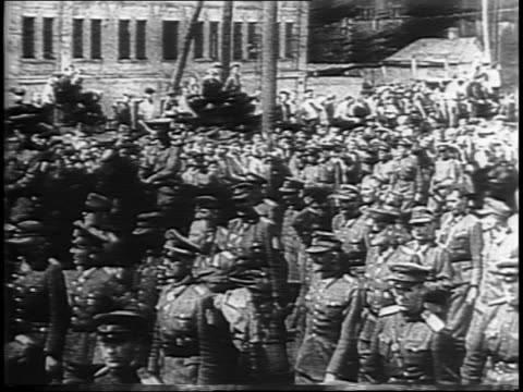flags fly over city square in moscow / crowds in red square / montage of of nazi prisoners marching russian onlookers - 1944 stock videos & royalty-free footage