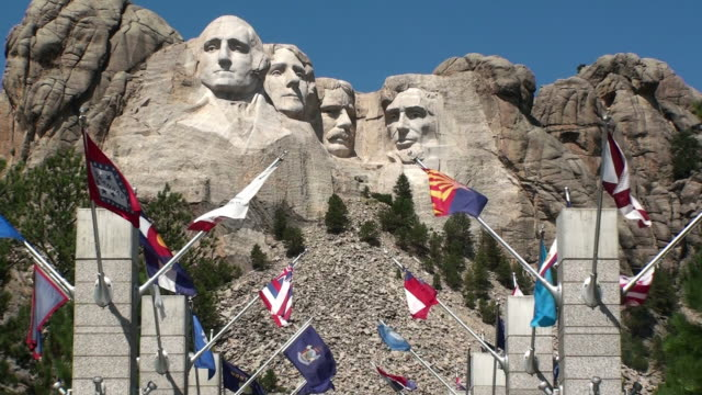 flags flying below mount rushmore - mt rushmore national monument stock videos and b-roll footage