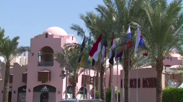 flags in front of hotel in hurghada - hurghada stock-videos und b-roll-filmmaterial
