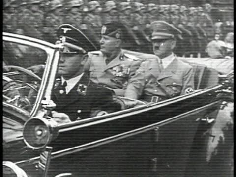 flags ms italian dictator benito mussolini german nazi adolf hitler riding in open convertible car through parade la ls nazi swastika banners on... - ベニート ムッソリーニ点の映像素材/bロール
