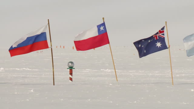 ms flags of antarctic treaty states at ceremonial south pole, australia, chile, russia / south pole, antarctica - treaty stock videos and b-roll footage