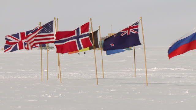 ms pan flags of antarctic treaty states at ceremonial south pole / south pole, antarctica  - south pole stock videos & royalty-free footage