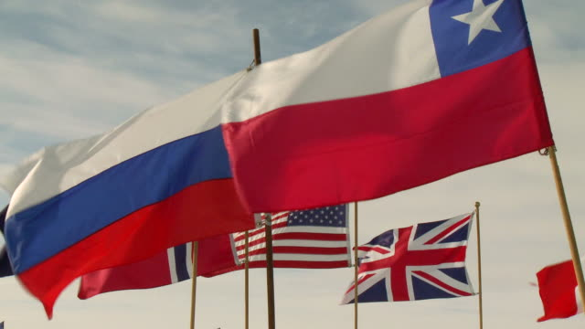 ms flags of antarctic treaty states, chile, russia, norway, us, britain / south pole, antarctica - south pole stock videos & royalty-free footage