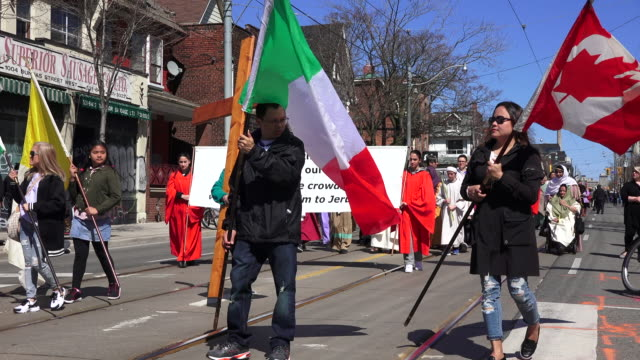 flags of italy and canada lead the christian procession during holy week - holy week stock videos & royalty-free footage