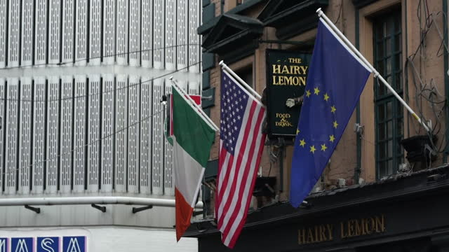 flags of republic of ireland, usa and eu outside pub in dublin - usa stock videos & royalty-free footage