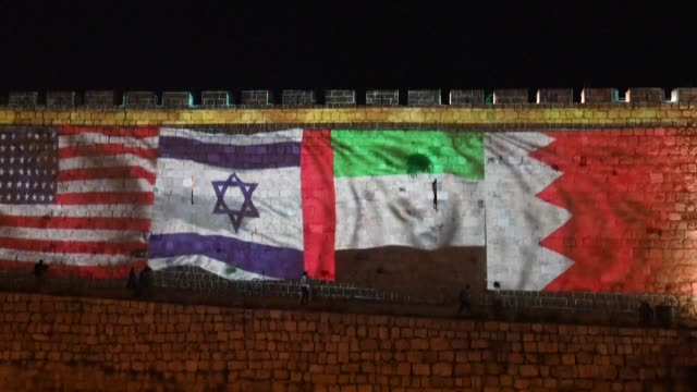 flags of the united arab emirates, bahrain, israel and the united states are projected on the walls of jerusalem's old city to mark the israeli... - jerusalem stock videos & royalty-free footage
