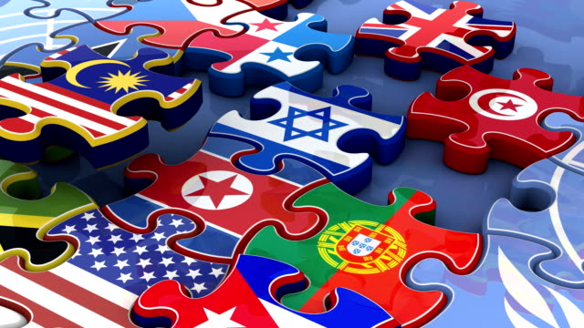 stockvideo's en b-roll-footage met flags of the united nations in moving puzzle pieces (loop) - puzzel