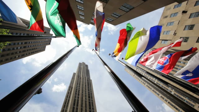 la flags of the world in rockefeller plaza / new york, new york, usa - rockefeller center video stock e b–roll