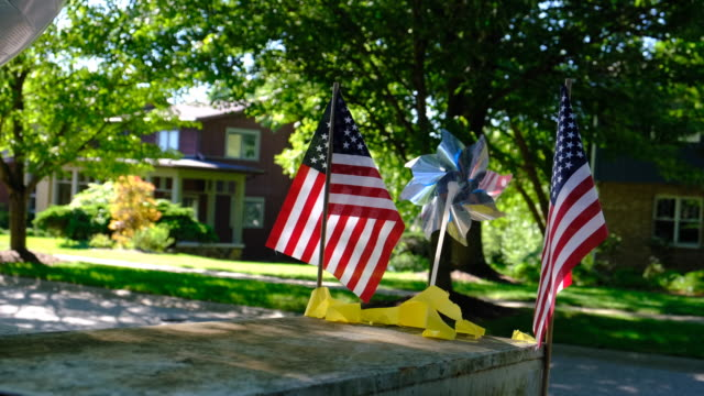 flags on a mail box. bloomington, indiana, united states - : a united states post office letterbox in the hyde park neighborhood of bloomington,... - time of day stock videos & royalty-free footage