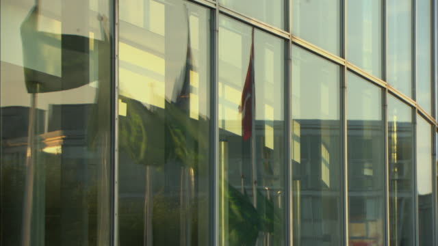 CU Flags reflected in windows of Bella Convention Center / Copenhagen, Denmark