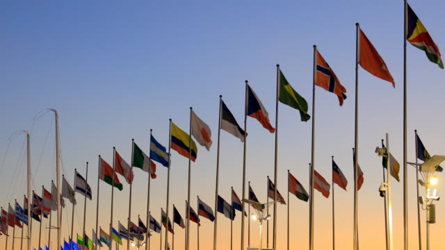 flags - global communications video stock e b–roll