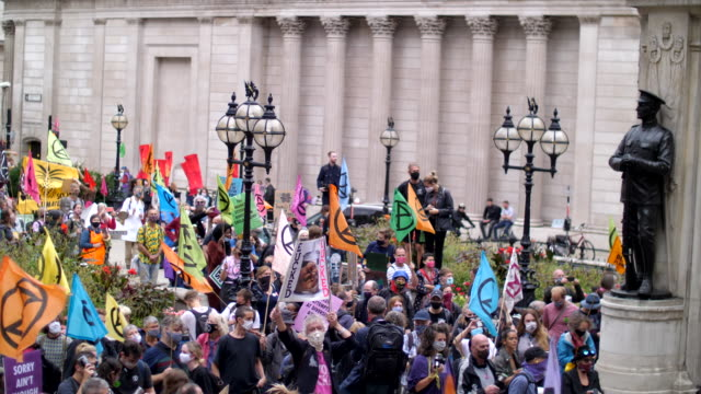 flags waving extinction rebellion protest london 2020 out side the bank of england with drummers and colourful flags - banner stock videos & royalty-free footage