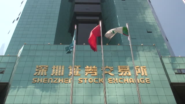 stockvideo's en b-roll-footage met la ms flags waving in front of shenzhen stock exchange/ shenzhen, china - chinese cultuur