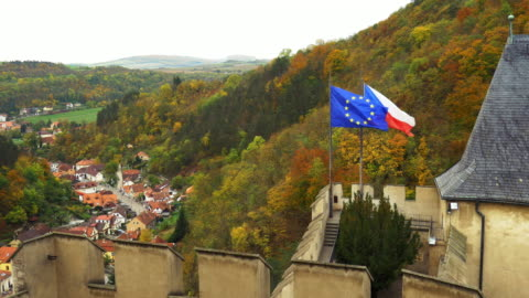flags waving on karlštejn castle (hhrad karlštejn, burg karlstein) in bohemia - czech republic stock videos & royalty-free footage