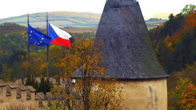 flags waving on karlštejn castle (hhrad karlštejn, burg karlstein) - czech culture stock videos & royalty-free footage