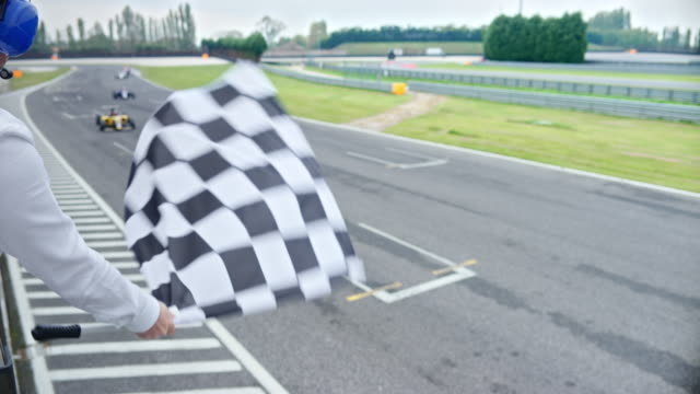 ld flagsman waving the chequered flag at the race - pitch stock videos & royalty-free footage