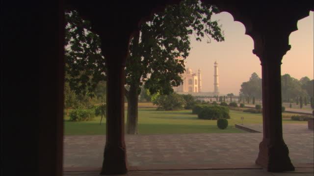 A flagstone walkway leads to the Taj Mahal.