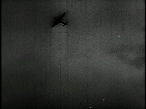 1947 REENACTMENT flak guns firing at enemy bombers during night air raid / United Kingdom
