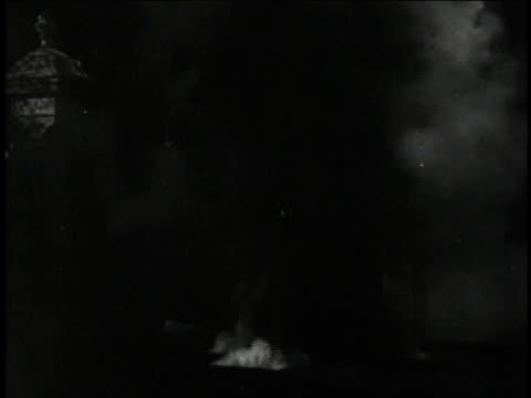 1947 reenactment flak guns firing during an air raid / united kingdom - air raid video stock e b–roll
