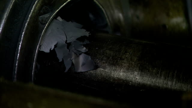 flakes of graphite litter an extruder in a pencil factory. - lead stock videos & royalty-free footage