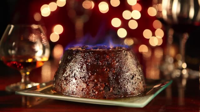 flambéing a christmas pudding - gourmet stock videos & royalty-free footage