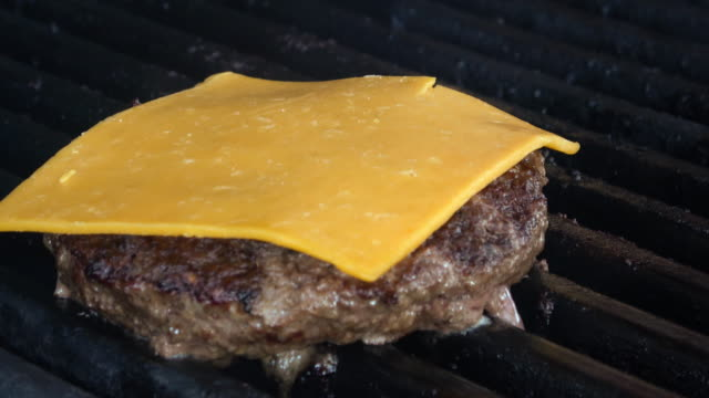 flame broiled cheeseburger - cheese stock videos & royalty-free footage