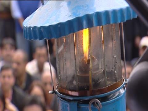 flame burning in lantern - burning stock-videos und b-roll-filmmaterial