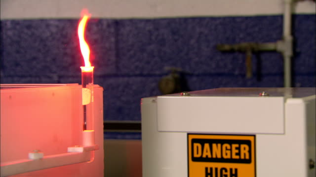 a flame flickers on a vial filled with flammable liquid. - flammable stock videos & royalty-free footage