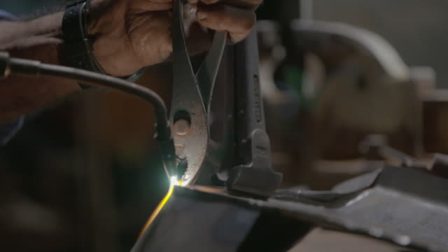 flame from welding torch on sheet metal held with pliers - sheet metal stock videos and b-roll footage
