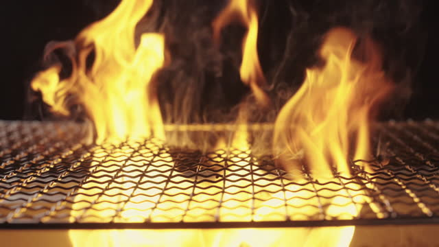 flame grill charcoal stove background - metal grate stock videos & royalty-free footage